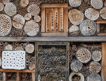 Insect hotel. Wooden insect hotel for different types of insects Stock Image