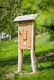 Insect hotel - wooden house made for bugs and solitary insect bees, wasps,... royalty free stock photography