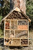 Insect House - Small artificial shelter or nest. Insect House for the protection of biodiversity. Small shelter or nest made from natural and artificial royalty free stock image