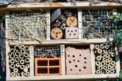 Insect House - Small artificial shelter or nest. Insect House for the protection of biodiversity. Small shelter or nest made from natural and artificial stock image