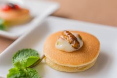 Insect pancake. Worm insect with Mayonnaise on the pancakes and mint leaf for breakfast. Close-up, Selective focus Royalty Free Stock Photo
