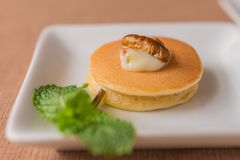 Insect pancake. Worm insect with Mayonnaise on the pancakes and mint leaf for breakfast. Close-up, Selective focus Royalty Free Stock Image