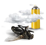 Insecticide spray bottle with dead fly Stock Image
