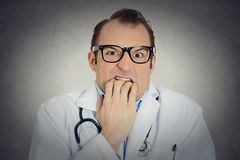 Insecure, crazy male doctor uncertain psychiatrist with glasses Royalty Free Stock Photos