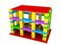 Insecure Goods. A gold bullion being in a Lego vault in not a great security idea Stock Images