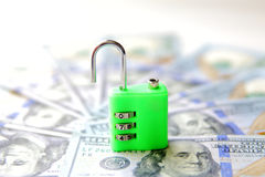Insecure money padlock concept. US dollars Royalty Free Stock Photos