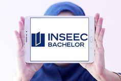 INSEEC Business School logo. Logo of INSEEC Business School on samsung tablet holded by arab muslim woman. The INSEEC Bachelor is a program in 3 years training royalty free stock images