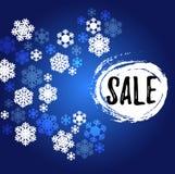 Insegna blu e bianca di vendita dei fiocchi di neve immagine stock