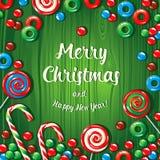 Insegna del manifesto della cartolina di Natale con le caramelle su un fondo di legno verde Illustrazione di vettore Fotografie Stock Libere da Diritti