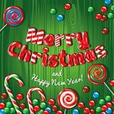 Insegna del manifesto della cartolina di Natale con le lettere del ghiaccio, i rami dell'abete, i regali e le caramelle su un fon Immagine Stock