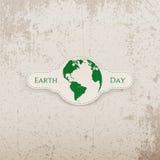Insegna di giornata per la Terra con il pianeta Immagine Stock