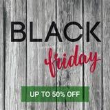 Insegna di vendita di Black Friday con a mano iscrizione e vecchio textur di legno Immagine Stock Libera da Diritti