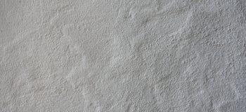 Insegna intonacata grungy bianca di struttura del fondo del muro di cemento del cemento fotografia stock