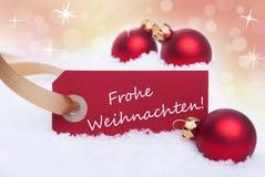 Insegna rossa con Frohe Weihnachten Fotografia Stock
