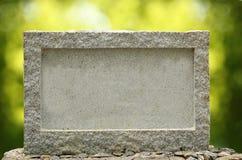 Insegna vuota del granito con il bordo & il blocco per grafici Fotografie Stock
