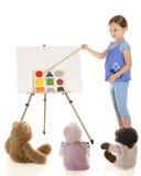 Insegnamento circa le figure Fotografia Stock