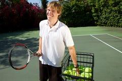 Insegnamento dell'istruttore di tennis Immagini Stock