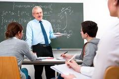 Insegnante con gli allievi della High School Immagini Stock Libere da Diritti