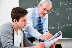 Insegnante con gli allievi della High School Immagini Stock