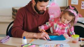 Insegnante dell'allievo di lezioni della carta di colore di origami Immagine Stock Libera da Diritti