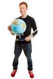 Insegnante di geografia che sorride e che tiene un globo Immagini Stock Libere da Diritti