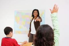 Insegnante ed allievi Fotografia Stock