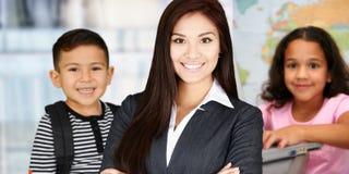 Insegnante ed allievi immagini stock