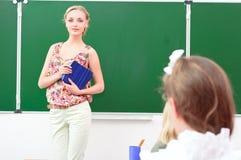 Insegnante ed allievi in aula Fotografie Stock