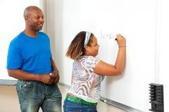 Insegnante ed allievo dell'afroamericano Fotografia Stock Libera da Diritti