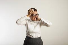 Insegnante femminile frustrato in vestiti conservatori Fotografie Stock