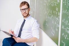 Insegnante intelligente serio Immagini Stock