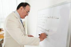 Insegnante per la matematica fotografie stock