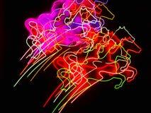 Insegne al neon dei cavalli nel movimento Immagine Stock
