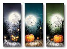 Insegne di Halloween di festa con le zucche e la luna Immagine Stock Libera da Diritti