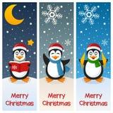 Insegne di verticale dei pinguini di Natale Fotografia Stock