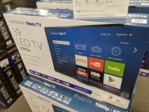 Insegne Roku TV da vendere l'affare nel migliore dei casi Immagine Stock