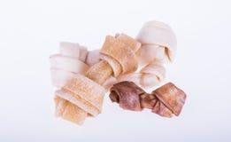 Insegua l'alimento favorito con le forme del bastone e dell'osso Fotografia Stock