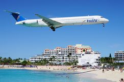An Insel Air MD80 plane lands over Maho Beach in St Martin. SAINT MARTIN, DUTCH ANTILLES --30 NOVEMBER 2014-- The beach at Maho Bay is one of the world's premier Royalty Free Stock Photography