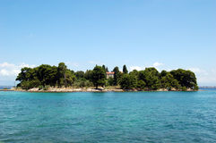Insel auf Meer Stockfotos