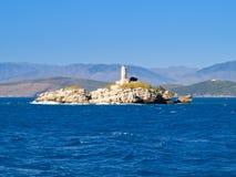Insel mit einem Leuchtturm Stockfoto