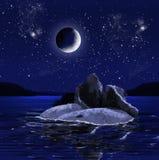 Insel mit Ruinen nachts Stockfotografie