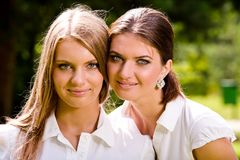We are inseparable lovely girlfriends Royalty Free Stock Images