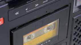 Insert Audio Cassettes into the Tape Player and Pushing Play, Stop Buttons. Insert Vintage Audio Cassettes into the Tape Player and Pushing Play, Stop Buttons stock video footage