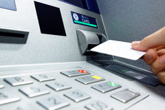 Insert card into ATM Stock Photography