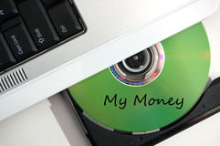 Insert CD My Money. A CD being put into a laptop computer that says my money Royalty Free Stock Photography