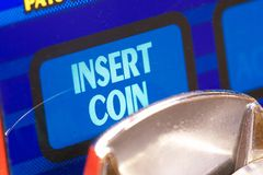 Insert coin. Blue insert Coin sign - blaues Geldeinwurfzeichen royalty free stock image