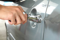 Insert the key to car handle Royalty Free Stock Images