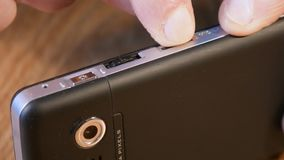 Insert the micro SD card in smartphone stock footage
