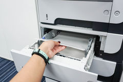 Insert paper into the printer. Tray Royalty Free Stock Images