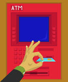 Insert or remove a debit card in ATM Stock Image